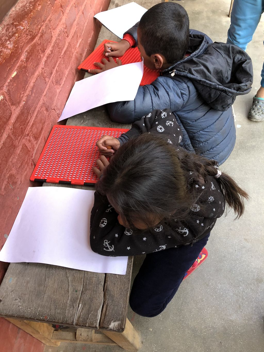 Children with visual impairments doing their homework